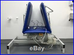 Blue vinyl, electric, 3 section physiotherapy, massage, tattoo table/couch/bed